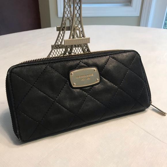 Michael Kors Handbags - Michael Kors zipp-around Quilted Black Wallet